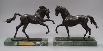 James Osborne. A pair of limited edition bronze horses, signed 'J. Osborne', one with a metal plaque