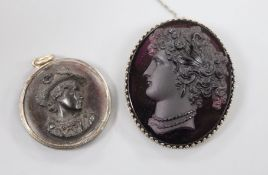 A metal mounted amethyst paste cameo carved with the bust of a lady to dexter and a tortoiseshell