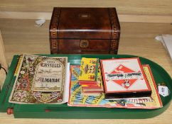An old Monopoly box (board missing) and an inlaid box, etc.