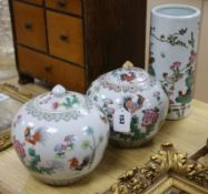 A pair of Chinese lidded jars with cockerel motif and a similar vase