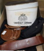 A boxed top hat, sporran, belt and jacket