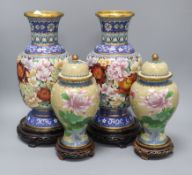 A pair of Chinese cloisonne enamel vases and covers and a pair of similar vases, wood stands tallest