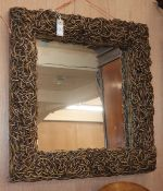 A contemporary wall mirror W.68cm