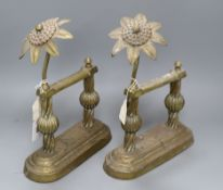 A pair of Arts & Crafts brass and copper passion flower andirons height 30cm