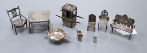 Eight assorted white metal miniature items including table and chairs and a plated sedan chair.