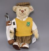 A Steiff golfer bear, boxed with bag 32cm