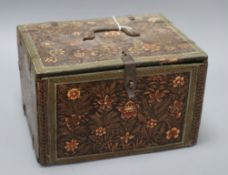 An Indian floral decorated lacquer casket height 18cm width 28cm