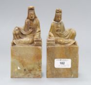 A pair of Chinese soapstone chops with seated figures height 16cm