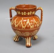 A 19th century Sussex slipware pottery tripod vase height 15cm