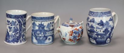 Three Chinese blue and white mugs, Qianlong period and a Chinese Imari teapot and cover, early