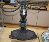 A Victorian cast iron dog and whip stick stand height 60cm