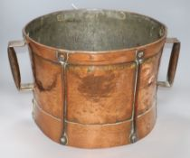 A hammered Arts and Crafts copper drum shaped two handled pot handle to handle 44cm