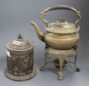 An electrotype plated biscuit barrel and a plated tea kettle on stand with burner.