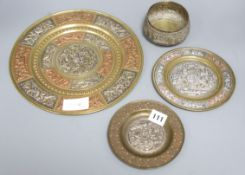 A mixed metalware set of Indian plates and a bowl