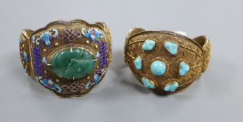 Two Chinese filligree gilt white metal hinged bangles, one set with turquoise, the other with