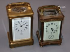 An early 20th century brass repeating carriage clock, retailed by Dent and one other brass