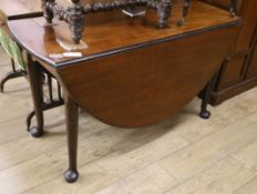 A George III mahogany drop leaf pad foot dining table W.126cm