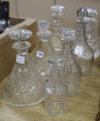 Seven various cut glass decanters