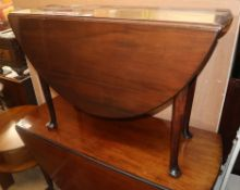 A George III mahogany dropleaf dining table W.104cm