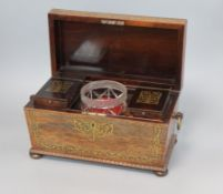A George IV brass inlaid rosewood tea caddy and associated sugar bowl length 31cm