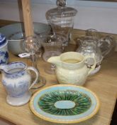 A quantity of cut glass including two jugs, two bowls and a maiolica dish