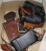 Five cameras and binoculars