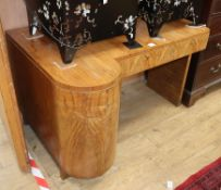 An Art Deco walnut kneehole dressing table W.120cm