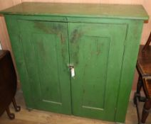 A Victorian painted pine two door cabinet W.110cm