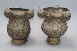 A pair of Indian embossed brass incense burners H.22cm
