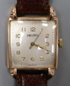 A gentleman's stylish 14k Helvetia manual wind wrist watch, with square Arabic dial and raised lugs,