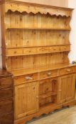 A Victorian style pine dresser with boarded rack W.140cm