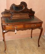 A late Victorian mahogany and beech writing table W.92cm
