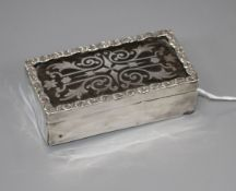 A silver and tortoiseshell trinket box containing dress studs