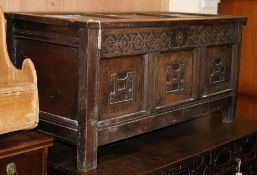 An 18th century carved oak panelled coffer W.126cm