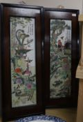 A pair of Chinese porcelain panels, painted with birds and inscribed, in ebonised frames with
