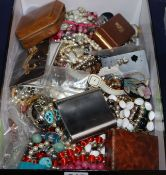 A large quantity of assorted costume jewellery including silver charms