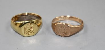 An 18ct signet ring with crest, gross 5.9 grams and a 9ct gold signet ring with monogram, 2.9 grams
