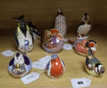 Nine Royal Crown Derby paperweights, gold stoppers, unboxed, including Penguin with Chick,