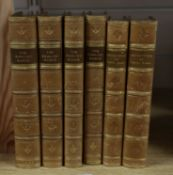 Four leather-bound volumes of 'The English Rogue' and two volumes of 'Ali Baba'