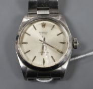 A gentleman's 1960's stainless steel Rolex Oyster precision manual wind wrist watch, on a