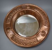An Arts and Crafts port hole mirror, in the John Pearson Style diameter 45cm