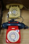 A red cream and blue Rotary phone and another