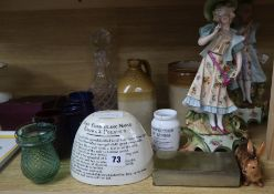 An advertising stoneware jug, a pair of porcelain figures, a jelly mould etc
