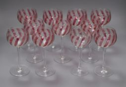 A set of eleven cranberry and etched wine glasses