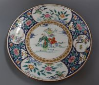 A Japanese polychrome-decorated charger, painted with figures, flowers and insects in reserves,