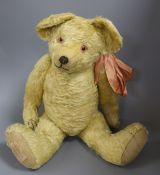An early English teddy, 24in, excellent condition with original clear glass eyes and paw pads