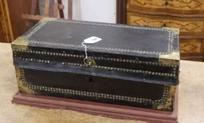 A late 18th / early 19th century brass studded leather covered camphorwood trunk
