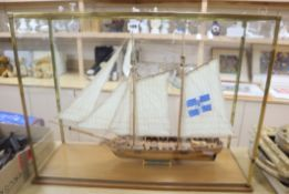 A cased model of a French naval schooner 'The Marseille 1764', in glazed case overall 84 x 63cm