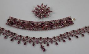 A suite of purple paste jewellery, comprising bracelet, necklace and brooch