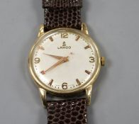 A gentleman's late 1950's 9ct gold Lanco manual wind wrist watch, with baton and Arabic numerals, on